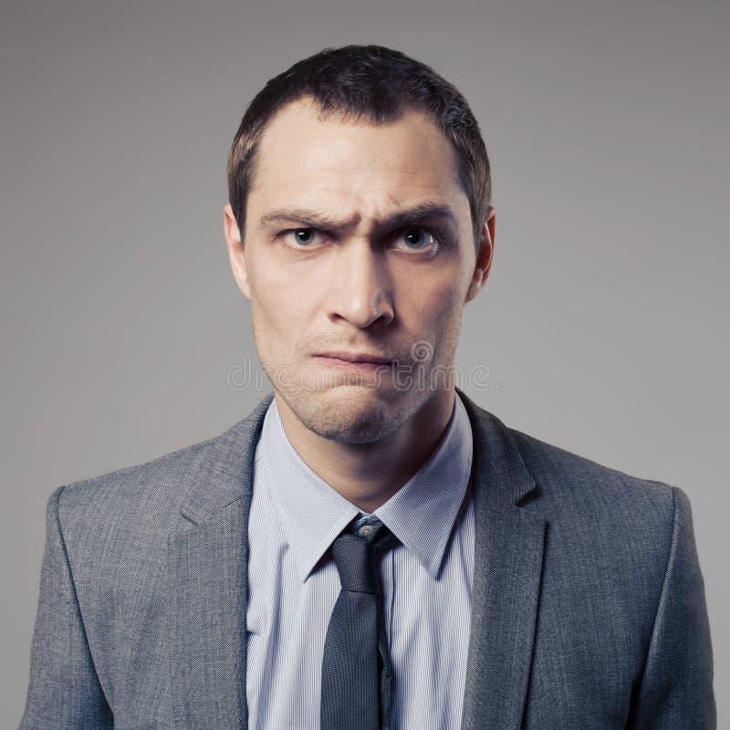 Hombre de negocios enojado On Gray Background imagen de archivo libre de regalías