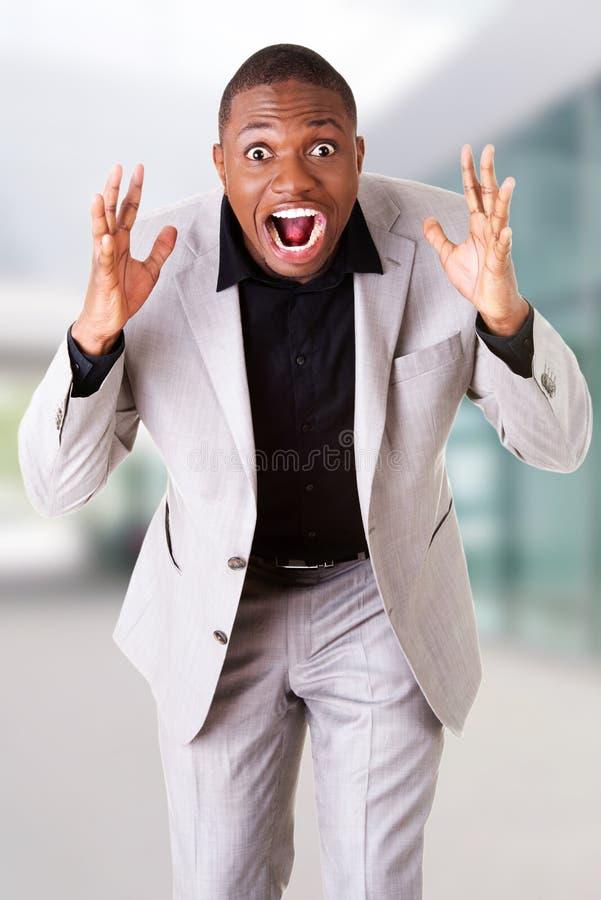 Hombre de negocios enojado joven fotos de archivo libres de regalías