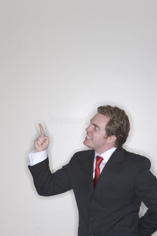 Hombre de negocios enojado y el señalar foto de archivo libre de regalías