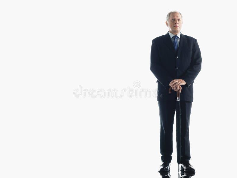 Hombre de negocios envejecido centro With Umbrella foto de archivo libre de regalías