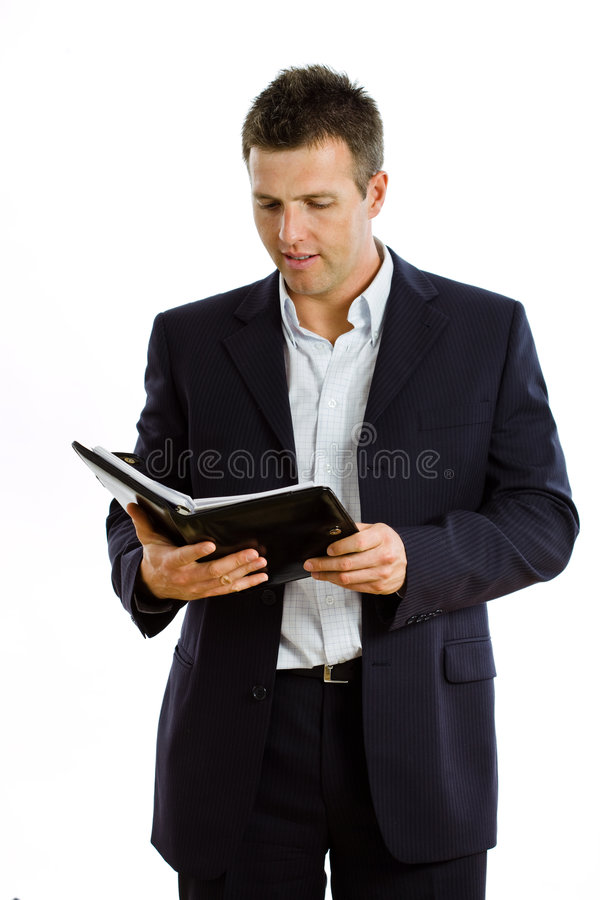 Hombre de negocios feliz con el cuaderno aislado fotos de archivo libres de regalías