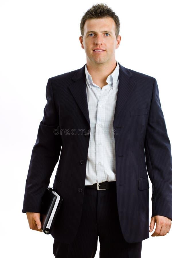 Hombre de negocios feliz con el cuaderno aislado foto de archivo libre de regalías