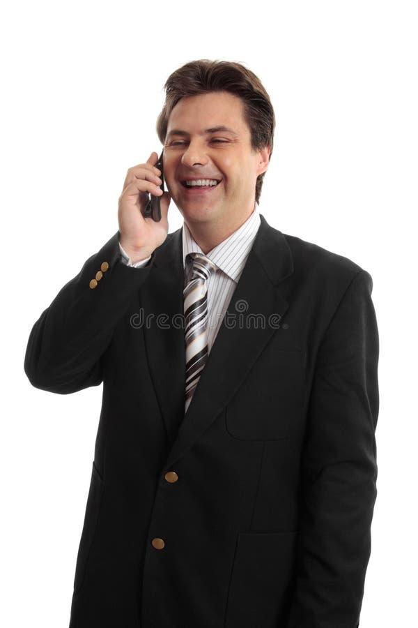 Hombre de negocios feliz en el teléfono fotografía de archivo