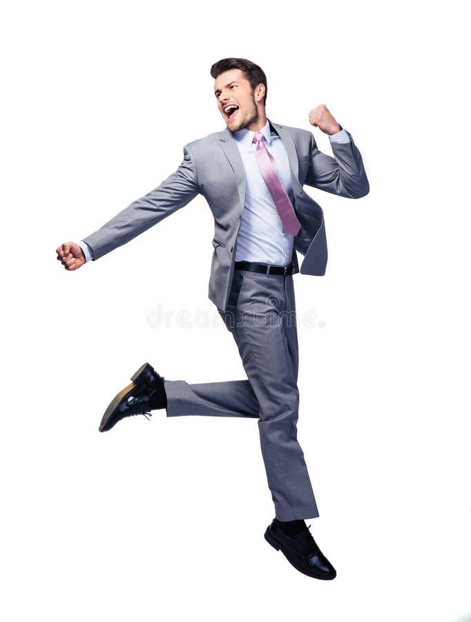 Hombre de negocios feliz que corre sobre el fondo blanco foto de archivo