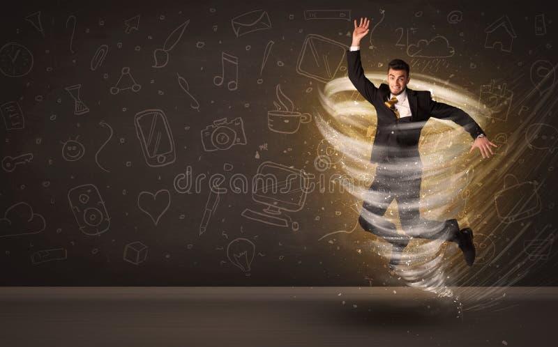 Hombre de negocios feliz que salta en concepto del tornado imagen de archivo libre de regalías