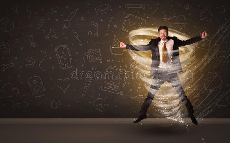 Hombre de negocios feliz que salta en concepto del tornado fotografía de archivo