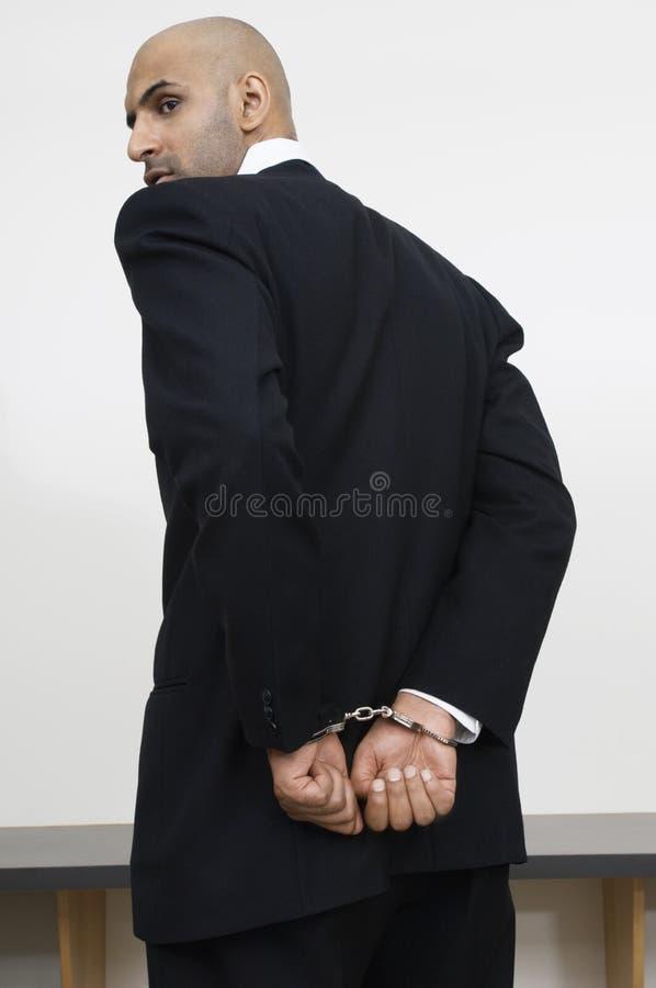 Hombre de negocios With Handcuffs fotografía de archivo