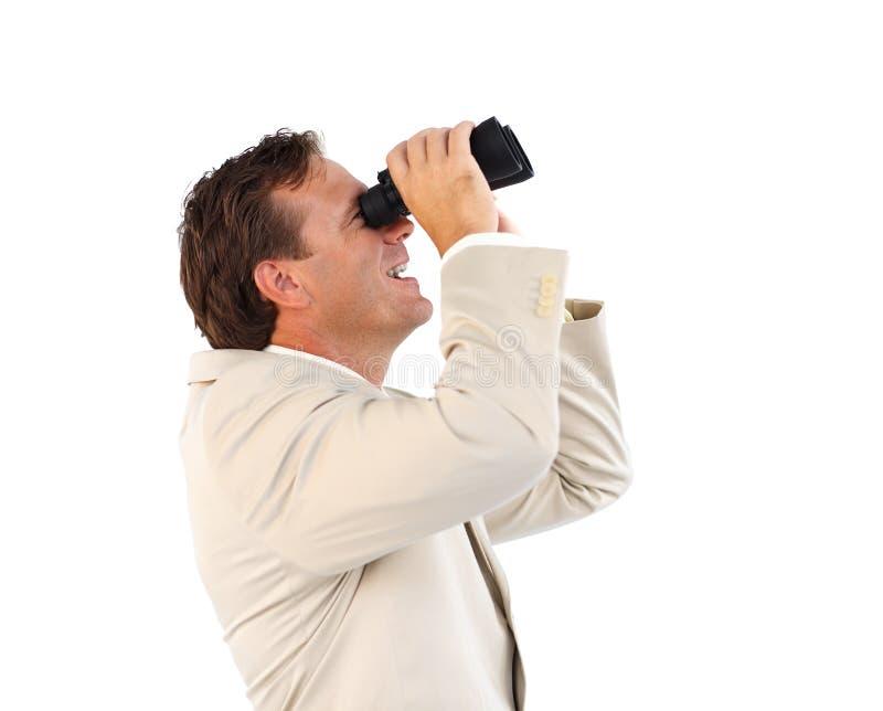 Hombre de negocios hermoso con los prismáticos fotografía de archivo libre de regalías