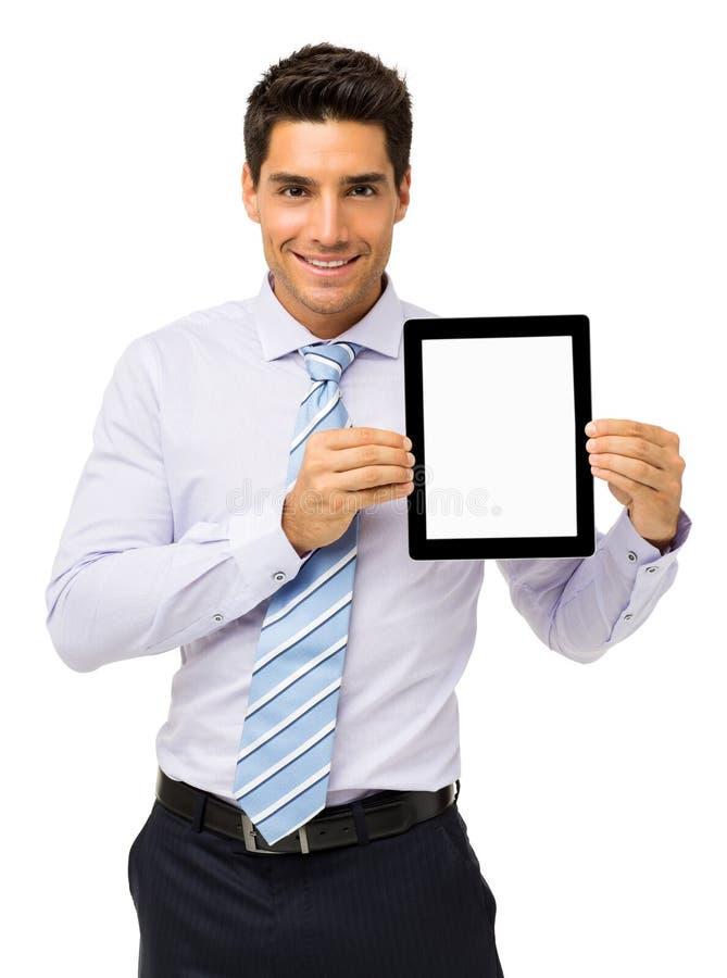 Hombre de negocios hermoso Promoting Digital Tablet imagen de archivo libre de regalías