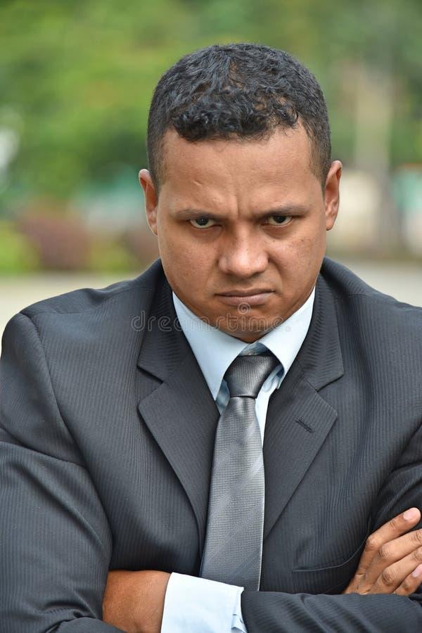 Hombre de negocios hispánico obstinado Wearing Business Suit fotos de archivo