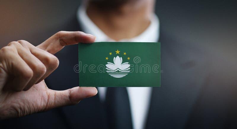 Hombre de negocios Holding Card de la bandera de Macao imagen de archivo libre de regalías