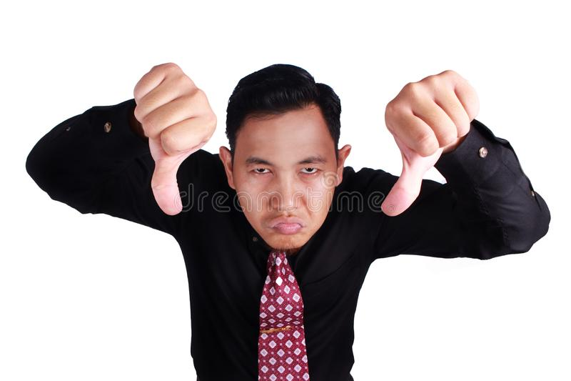 Hombre de negocios hosco Shows Thumbs Down fotos de archivo