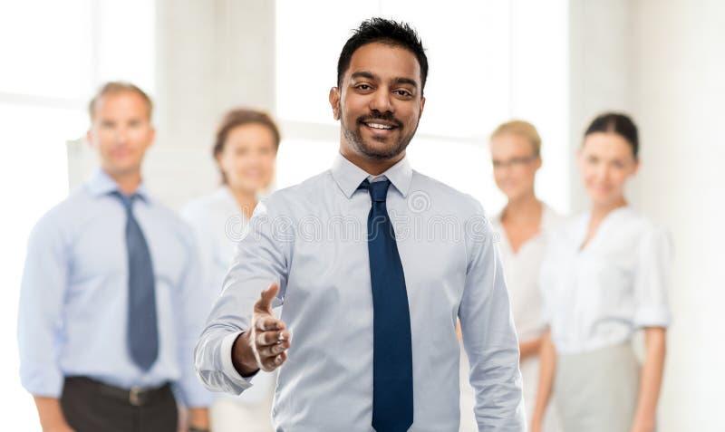 Hombre de negocios indio que estira la mano para el apretón de manos foto de archivo libre de regalías