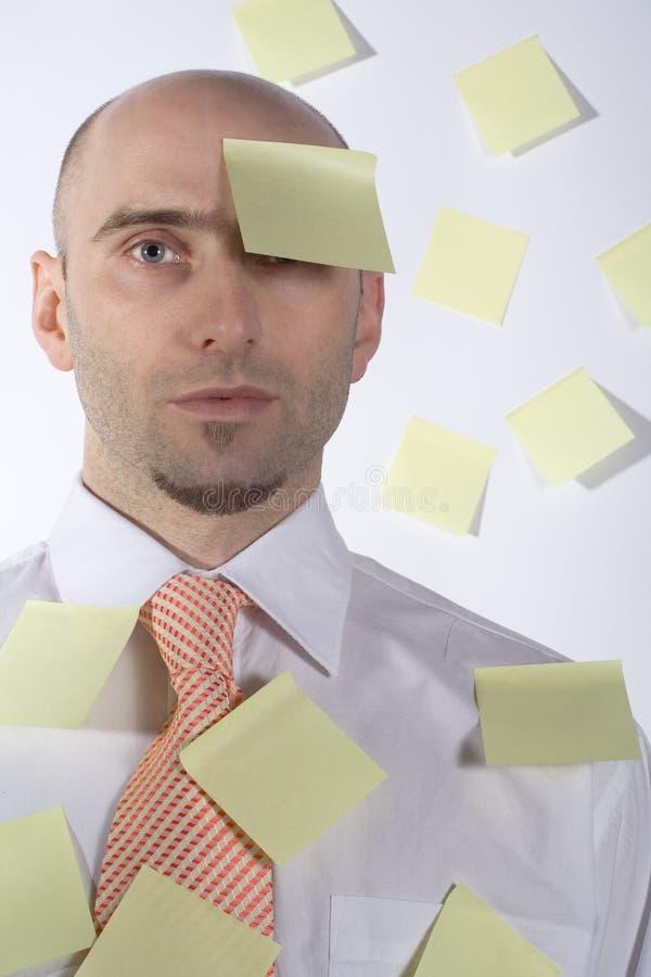 Hombre de negocios inorganizado, olvidadizo imagen de archivo