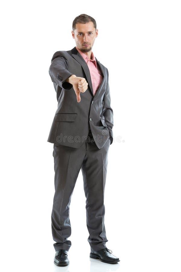 Hombre de negocios integral del lazo del traje con el pulgar abajo foto de archivo
