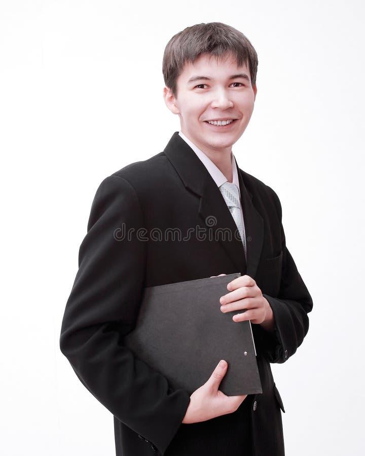 Hombre de negocios joven acertado con los documentos Aislado en blanco fotos de archivo libres de regalías