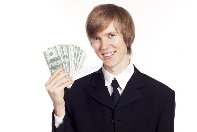 Hombre de negocios joven con efectivo imagenes de archivo