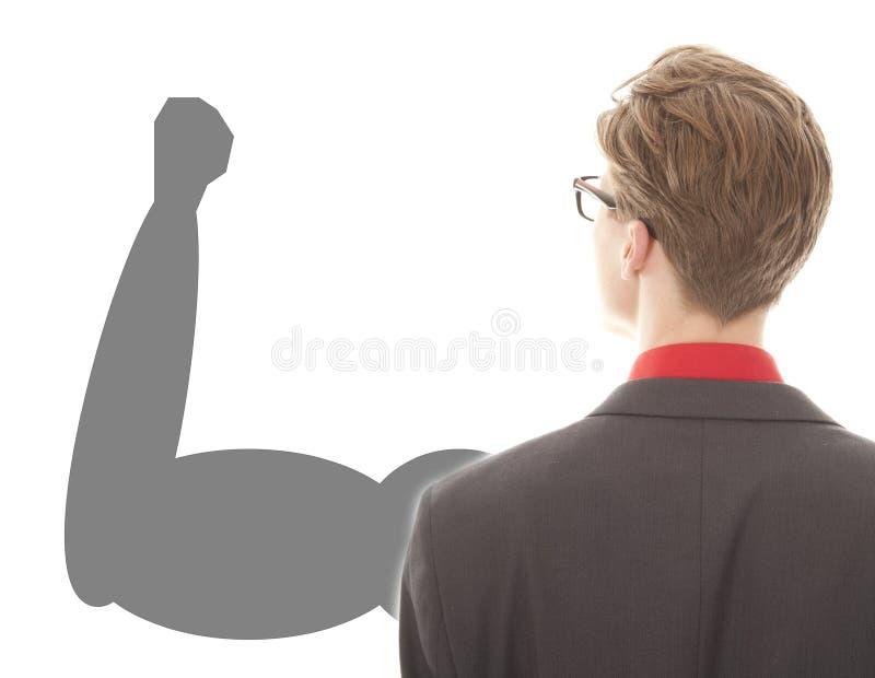 Hombre de negocios joven con el brazo potente fuerte foto de archivo