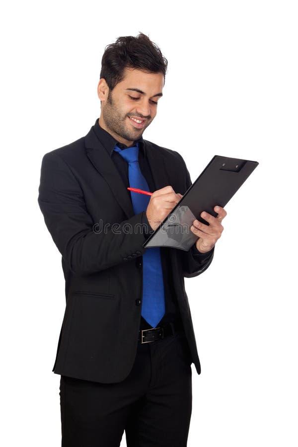 Hombre de negocios joven con el lazo azul con un tablero fotos de archivo