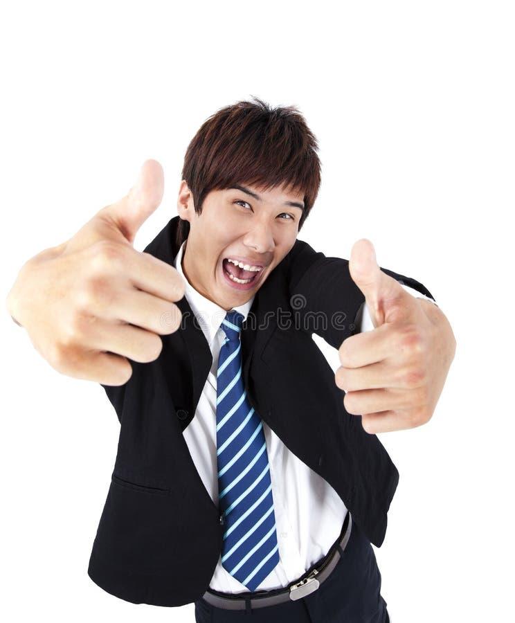 Hombre de negocios joven con el pulgar para arriba imagen de archivo