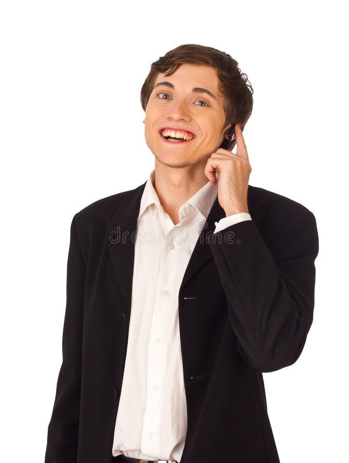 Hombre de negocios joven con el receptor de cabeza fotografía de archivo libre de regalías