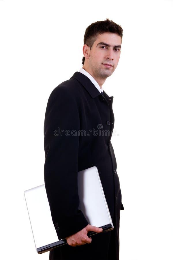 Hombre de negocios joven con la computadora portátil fotografía de archivo