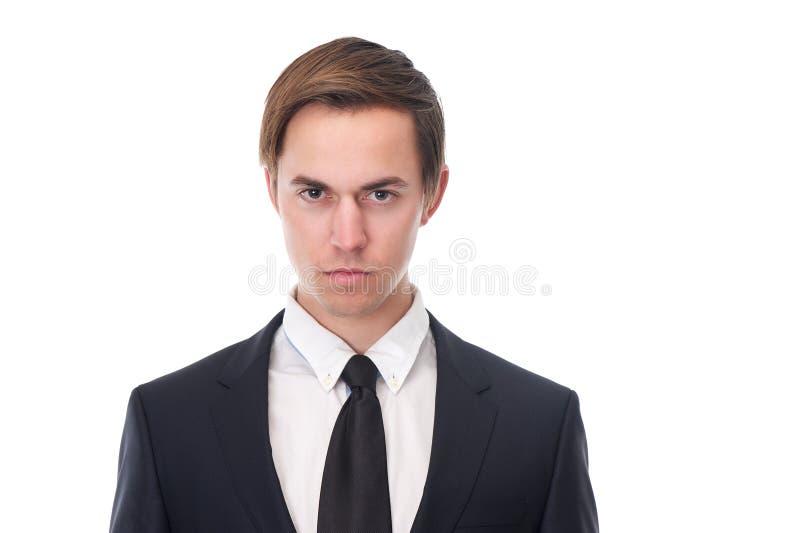 Hombre de negocios joven con la expresión seria en su cara imagen de archivo