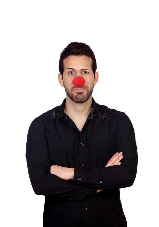 Hombre de negocios joven con la nariz del payaso imagen de archivo libre de regalías