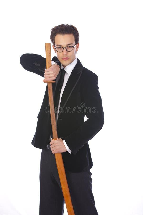 Hombre de negocios joven con su espada imagenes de archivo