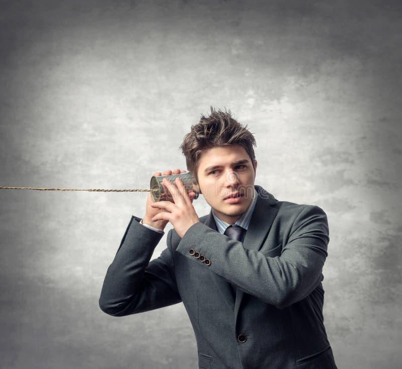 Hombre de negocios joven - concepto del teléfono foto de archivo libre de regalías