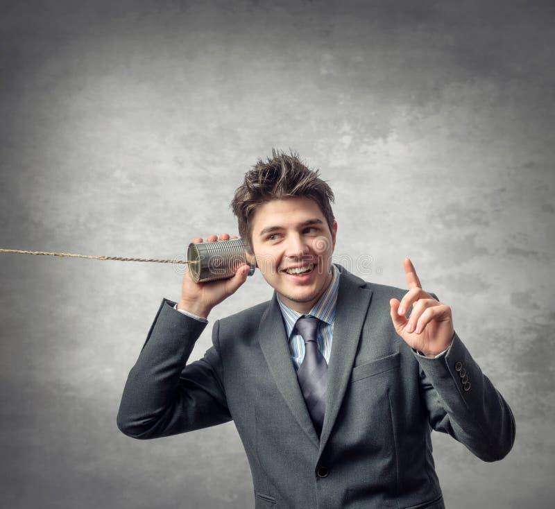 Hombre de negocios joven - concepto del teléfono imagenes de archivo