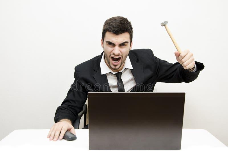 Hombre de negocios joven Desk Rage fotos de archivo libres de regalías