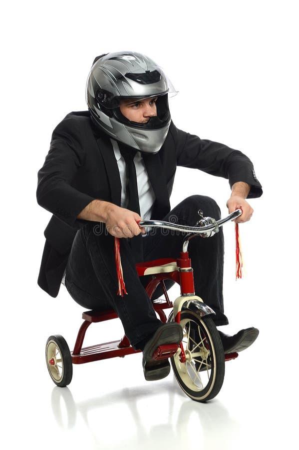 Hombre de negocios joven en el triciclo imágenes de archivo libres de regalías