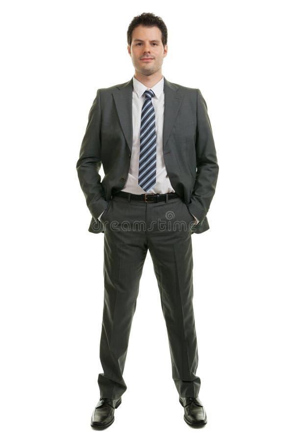 Hombre de negocios joven en la situaci?n integral aislado en el fondo blanco Negocio, oficina y concepto del ?xito fotografía de archivo
