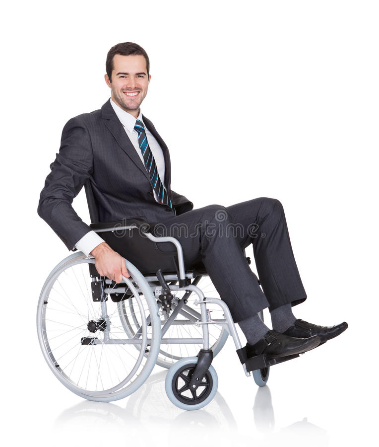 Hombre de negocios joven en silla de ruedas fotos de archivo