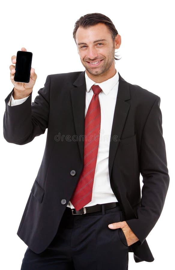 Hombre de negocios joven hermoso que habla en el teléfono fotos de archivo libres de regalías