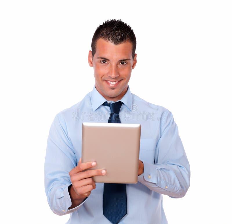 Hombre de negocios joven hermoso usando su PC de la tableta foto de archivo libre de regalías
