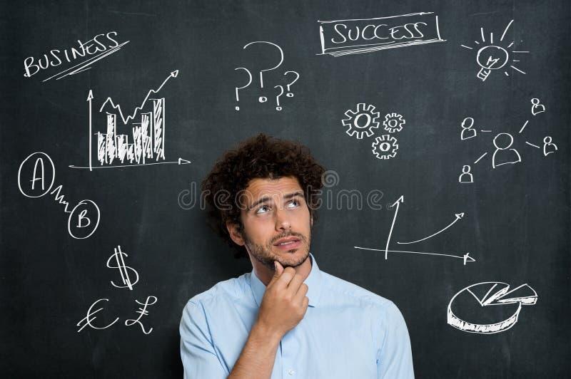 Hombre de negocios joven incierto Thinking foto de archivo libre de regalías