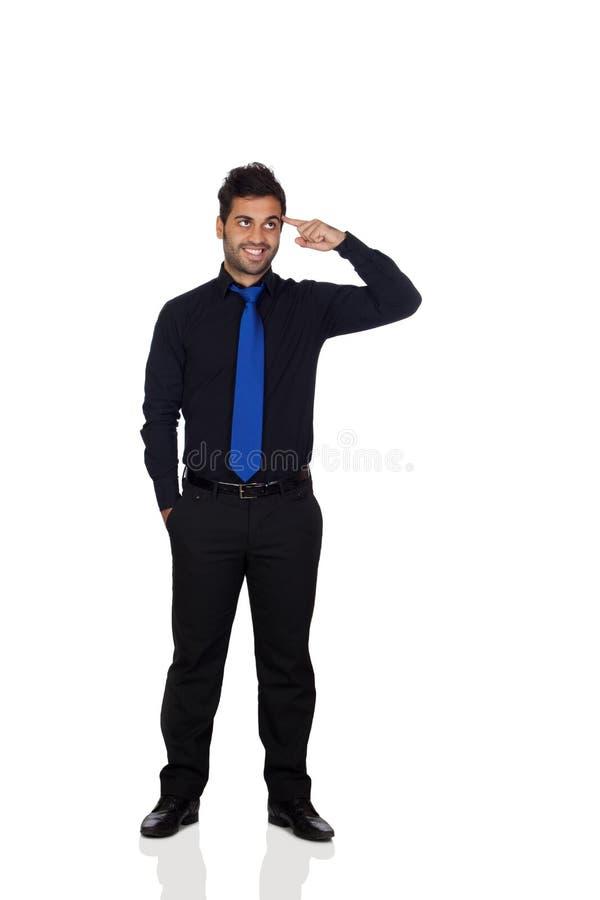 Hombre de negocios joven pensativo With Blue Tie fotografía de archivo libre de regalías