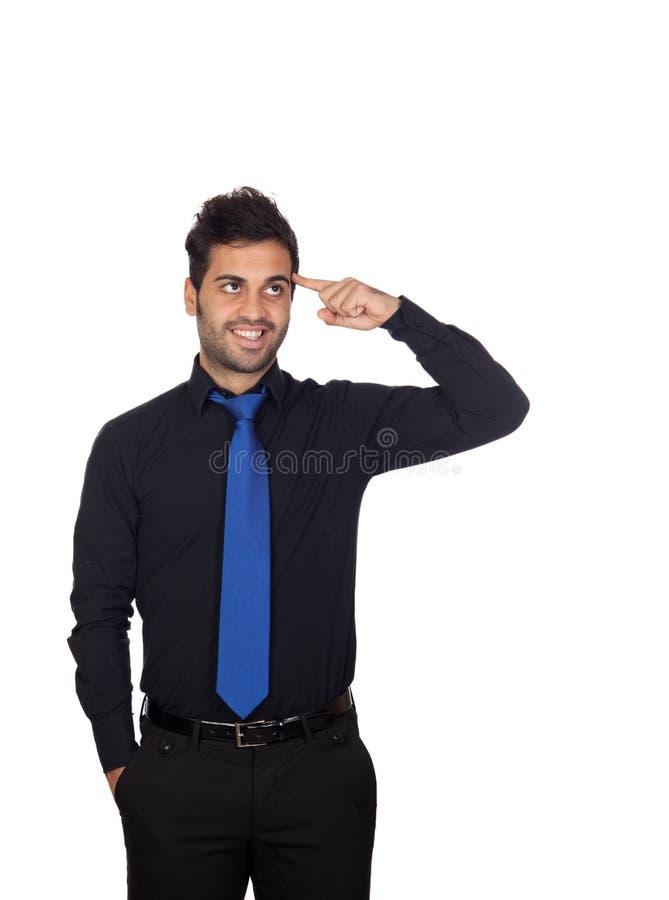 Hombre de negocios joven pensativo con el lazo azul imágenes de archivo libres de regalías