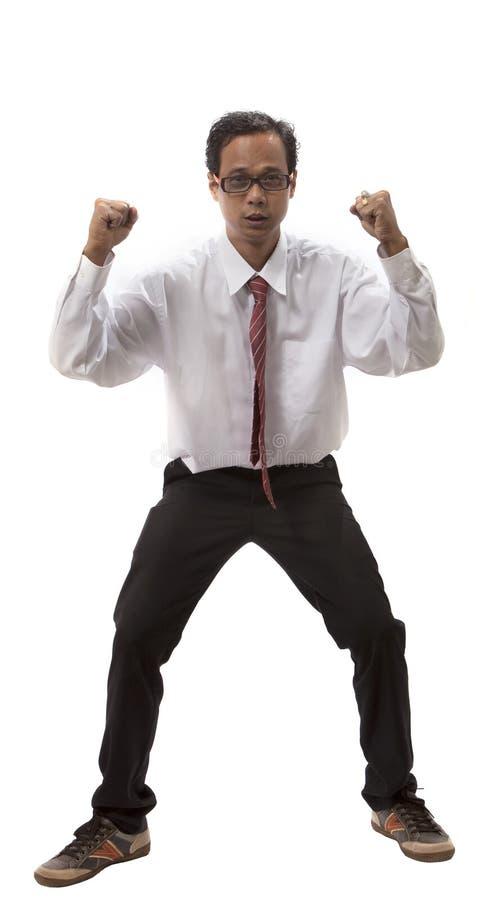Hombre de negocios joven que actúa para la emoción feliz imagen de archivo