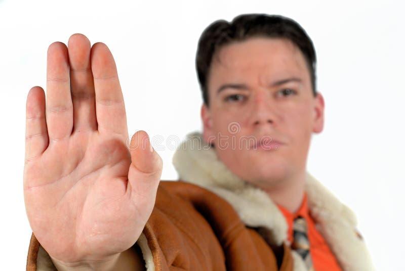 Hombre de negocios joven que da la muestra de la parada con la mano fotografía de archivo