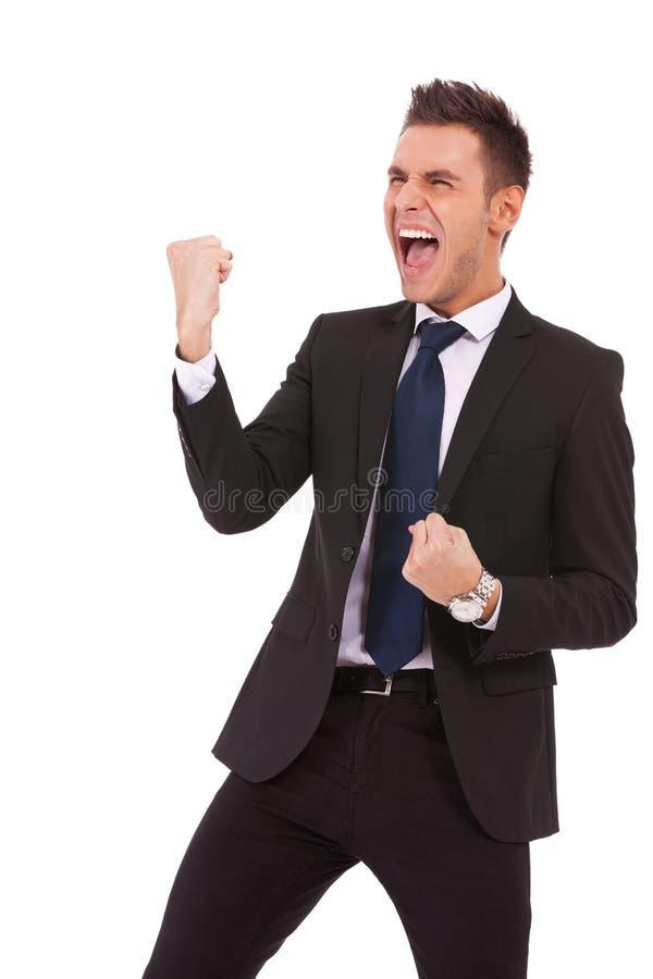 Hombre de negocios joven que disfruta de éxito fotografía de archivo