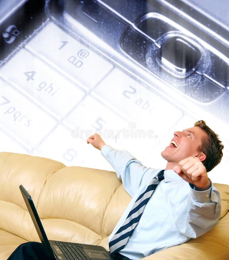 Hombre de negocios joven que disfruta de un éxito imágenes de archivo libres de regalías
