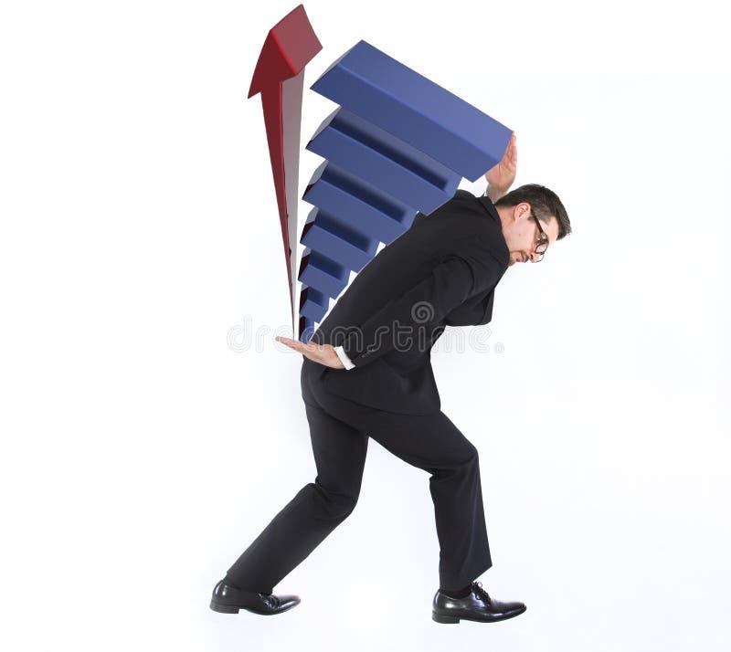 Hombre de negocios joven que lleva un gráfico imagen de archivo libre de regalías