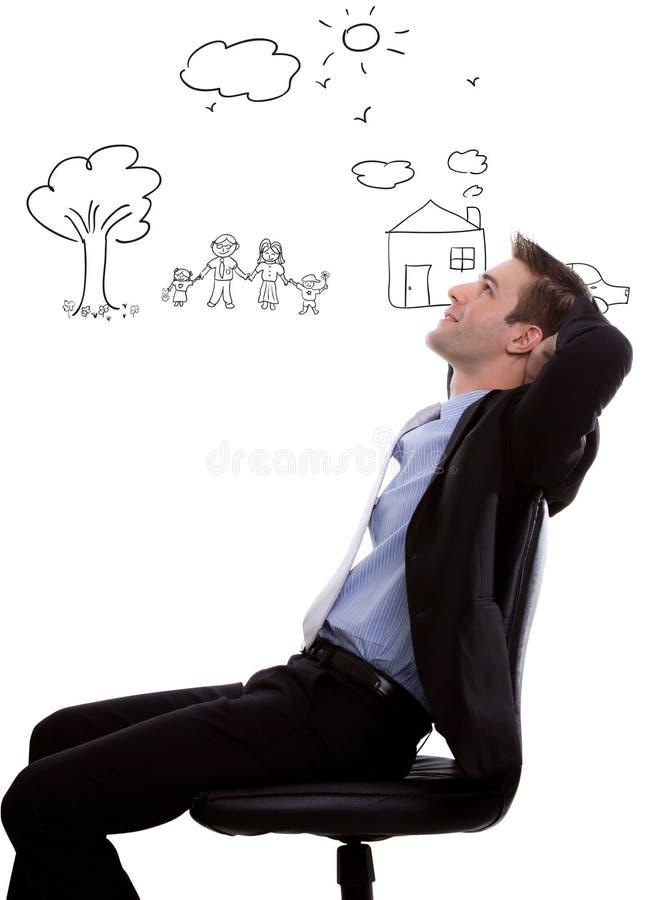 Hombre de negocios joven que mira para arriba y que planea foto de archivo