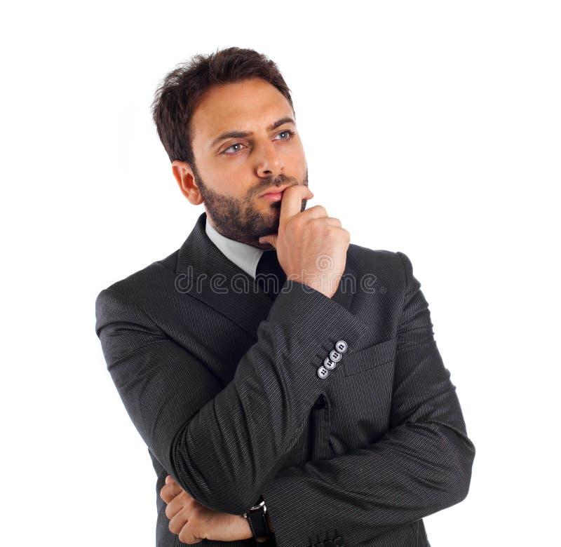 Hombre de negocios joven que piensa y que refleja. fotos de archivo libres de regalías
