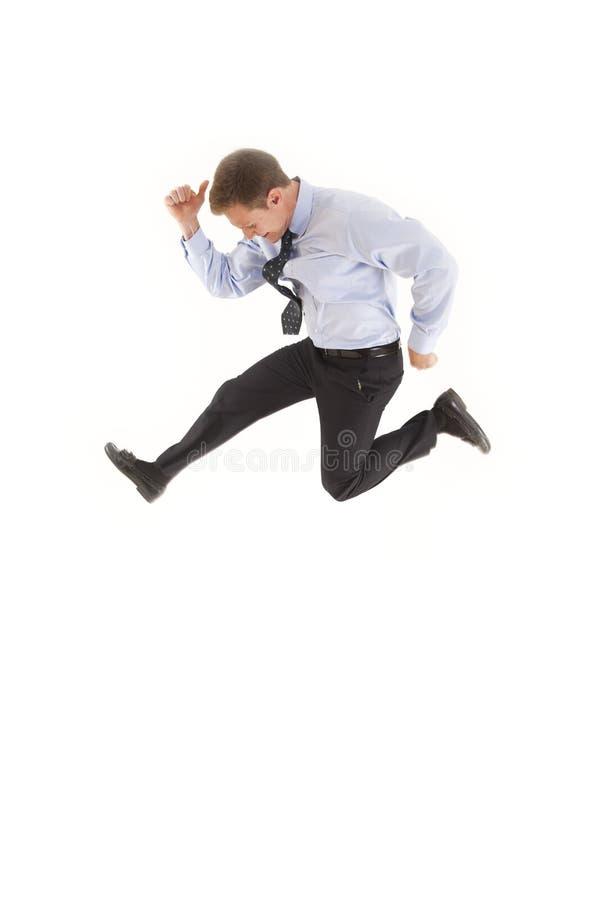 Hombre de negocios joven que salta en el aire fotos de archivo