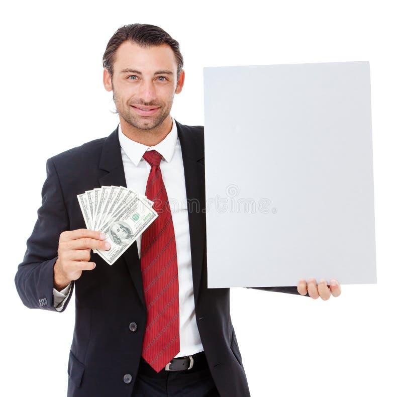 Hombre de negocios joven sonriente que lleva a cabo un cartel fotografía de archivo libre de regalías