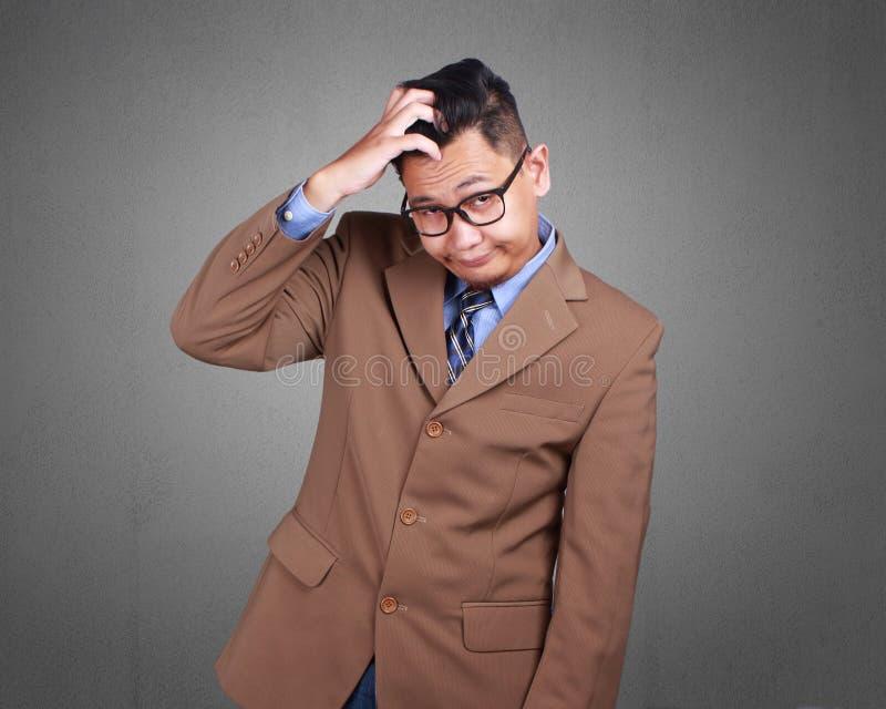 Hombre de negocios joven Stressed, expresión confusa imágenes de archivo libres de regalías